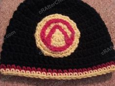 A geeky crochet rendition of the Vault symbol for Borderlands video game appliqued on to the color schemed crochet hat. An easy free crochet novelty hat pattern. Crochet For Kids, Diy Crochet, Crochet Crafts, Crochet Projects, Crochet Applique Patterns Free, Free Pattern, Geek Crafts, Crochet Videos, Crochet Accessories