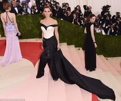 Show-stopper: Emma looked exquisite in a monochrome ensemble that featured a long train, t...