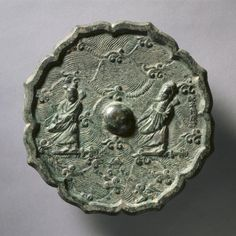 Octafoil Mirror with Two Immortals Crossing the Ocean, mid 10th-late 13th century, China, Song dynasty (960-1279), bronze, Diameter - w:17.60 cm (w:6 7/8 inches) Wt: 606 g Overall - h:1.00 cm (h:3/8 inches) Rim - h:0.60 cm (h:3/16 inches). Gift of Drs. Thomas and Martha Carter in Honor of Sherman E. Lee 1995.378, Cleveland Museum of Art