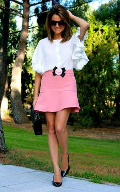 White ruffled blouse with pink skirt.