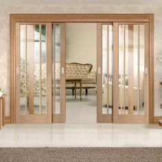Four Sliding Doors and Frame Kit – Worcester Oak 3 Pane Door – Clear Glass – Prefinished Thruslide Worcester Oak – 4 Sliding Doors and Frame Kit – Clear Glass – Prefinished – Lifestyle Image. Partition Door, Room Partition Designs, Room Divider Doors, Room Doors, Closet Doors, Wooden Room Dividers, Wooden Sliding Doors, Sliding Door Design, Wooden Door Design