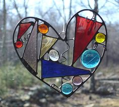 Stained glass heart suncatcher colorful by DesignsStainedGlass, cute use of scrap glass!