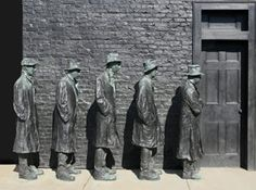 Depression Bread Line depicts five men in shabby trench coats and hats standing in line in front of a brick wall and doorway. As was George Segal's custom, the figures in Depression Bread Line were cast from friends of the artist. The original work in plaster was used to produce a mold for bronze casting. The five individuals, hunched over in downcast isolation, await their rations of food, playing out an all-too-familiar scene from the Great Depression of the late 1920s and 1930s.