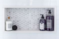master bathroom - all white glass tile & marble hexagon tile shower niche