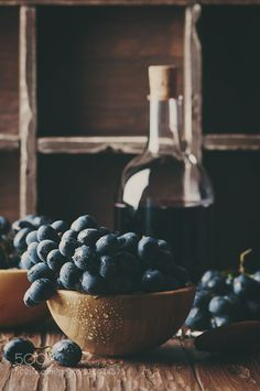 Fresh grape and red wine on the vintage table by OxanaDenezhkina