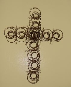 Cross made from bed springs!