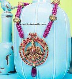 ruby-beads-garuda-pendant.jpg 631×689 pixels