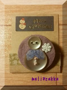 handmade magnet ... luckily i can find some lovely buttons to make the snowman ^.^