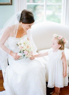 How melt-worthy is this bride & flower girl moment?! http://www.stylemepretty.com/north-carolina-weddings/raleigh/2015/09/25/romantic-coral-navy-inspired-wedding/ | Photography: Faith Teasley - http://faithteasley.com/