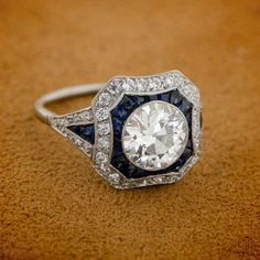 An beautiful and amazing engagement ring! Estate Diamond and Sapphire Engagement Ring.