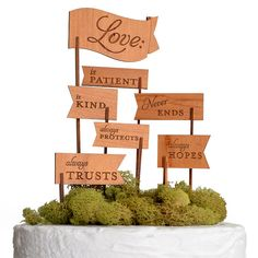 Christian Wedding ideas; cake topper with bible verse 1 Corinthians 13. For more Christian wedding ideas see http://www.knotsvilla.com/10-ideas-for-a-christian-themed-wedding/