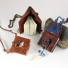'Wisdom Keepers' (book pendants) by Mia Leijonstedt