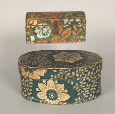 """Two wallpaper covered boxes, 19th c., 4 1/4"""" x 9 1/2"""" and 3 3/4"""" x 7 1/2""""."""