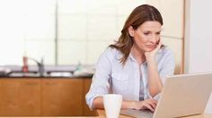 Woman sitting in front of computer