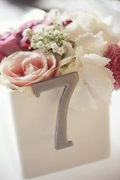 Box of flowers for center piece and table number!