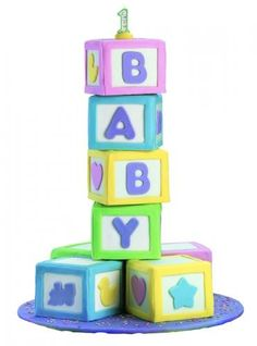 This is one of my personal favorite birthday cakes. This baby block cake is the perfect first birthday cake. For more ideas on birthday cakes visit our site www. Baby Shower Cakes Pictures, Baby Shower Themes, Shower Ideas, Cake Pictures, Wilton Cake Decorating, Cake Decorating Tools, First Birthday Cakes, Baby Birthday, Birthday Ideas