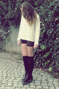 Cream White Jumper (Sweater), Black Shorts with Rhinestone Decoration, Black Knee-High Socks, and Black Boots