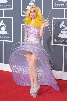 Lady Gaga might have been making some deep commentary on pop ~stars~ with this celestial but cumbersome dress at the 52nd Grammy Awards.