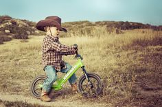 Toddlers on a Strider bike + cowboy boots = too much cuteness.