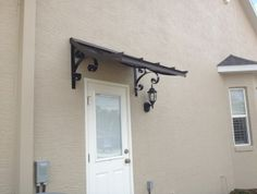 Concave Metal Awning - Bronze with Lazy Scrolls