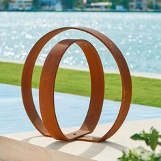 Put an inspired finishing touch on your garden space with a work of adaptable art, using our sleek Orb Garden Sculpture. The two concentric spheres are hinged at the bottom, so you can pivot the inner circle for the exact look you want-and change the profile whenever the spirit strikes. Rustic weathered finish will continue to gain distinctive character with each passing season. Garden sculpture composed of two concentric circles Artisan-crafted from solid ...