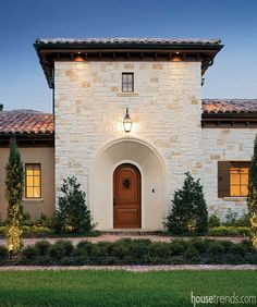 Arched entry door creates a Tuscan atmosphere