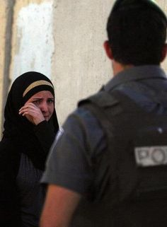 A Palestinian girl cries as an Israeli soldier preventes her from crossing a check point to visit her mother in Hospital. This is part of our Ramadan.