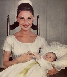 Mrs. Audrey Hepburn Ferrer photographed by Richard Avedon with her son Sean, at his christening party, at the Golf Club of Bürgenstock in Bürgenstock (Switzerland), on September 14, 1960.