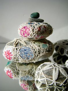 fabric and crochet covered stones. Just gorgeous. From my favourite blogger 'resurrectionfern'