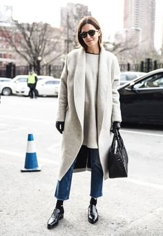 Gala Gonzalez in an elevated wool coat matched with an oversize sweater, cropped jeans, and polished loafers