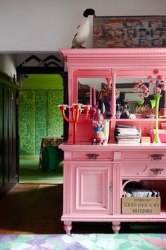 belle maison: pink buffet -- the color is not everyone's speed, but isn't it a happy contrast between the painted piece and the bright green room in the background?