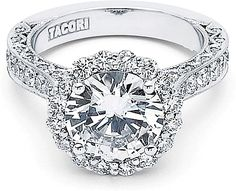 "Tacori RoyalT Pave Diamond Halo Engagement Ring  : A halo of round diamonds blooms your choice of a center stone of this ""RoyalT"" collection engagement ring. Channel set rounds are set three quarters way along the band with Tacori crescent details on the interior profiles."