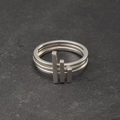 """vertical lines"" stacking rings from etsy. love these!"