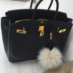 We're drooling over this black Hermés beauty with a pom pom keychain.