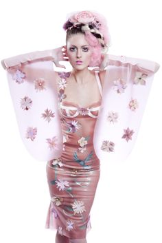 Semi-transparent pastel pink latex dress with flower applique's and long draping kimono-type sleeves. Lots of beautiful pastels and applique work went into making this dress.. Buy the supplies to make this: http://mjtrends.com/pins.php?name=semi-transparent-pink-latex-sheeting