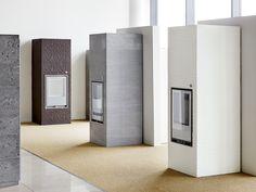 Tulikivi soapstone fireplaces. Hiisi fireplace family. Soapstone, Fireplace Design, Fireplaces, Tall Cabinet Storage, Studios, Divider, House Ideas, Rustic, Room
