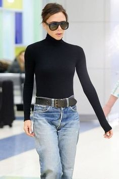 Loving this simple black turtleneck with baggy jeans and an oversized belt on Victoria Beckham. Chic!
