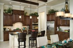 lighter walls with island different than the rest of the cabinets