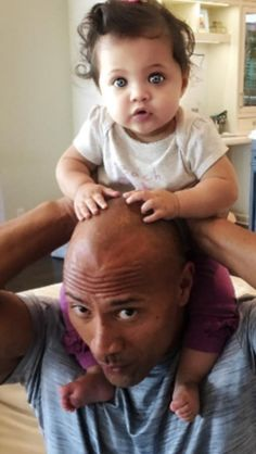 The Rock and his baby girl ((lemme just say...she drums on his head :)<3))