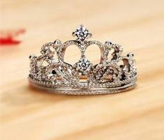 Every princess needs her crown, even if it is only a ring! It would make a good middle finger ring.