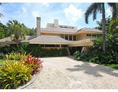Private, gated, & surrounded by tropical landscaping. 5 bedrooms/6.5 baths, Listing Price:$2,350,000