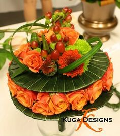 Contemporary bouquet in orange and green.