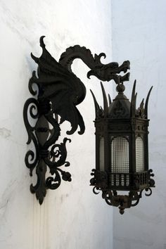 Dragon Lamp Holder. I must have this for my entrance! Along with the Gargoyle sculptures, purple door, besom over the door, and protection wreath...and of course some pretty flowers!