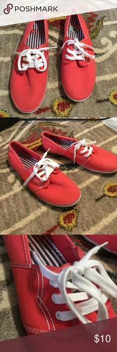 Levi's Casual Red Tennis Shoe These are great shoes I only wore a few times! They were in my car for when I forgot closed toed shoes at my volunteering position. They have very little signs of wear! Levi's Shoes Flats & Loafers
