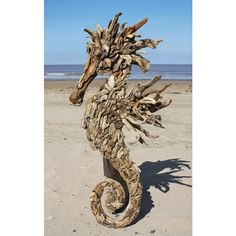Artistic seahorse sculpture, created using driftwood is perfect decor for a spectacular Pool House.