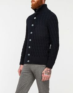I think I need a super heavy knit cardigan, such as this one.  Navy Blue Stark