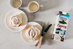 A recipe for overnight eggnog cinnamon rolls with a brown butter, cinnamon and nutmeg swirl and eggnog cream cheese rum icing from Hummingbird High.