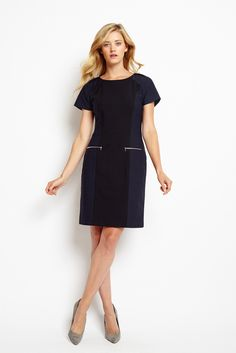 A stylish update on our popular Thompson dress, the Leopard Thompson features a luxe black wool body with contrasting stretch leopard-jaquard panels, offering both structure and comfort. Pleated short sleeves add a touch of femininity and high shine exposed zippers infuse this figure skimming silhouette with a contemporary edge.