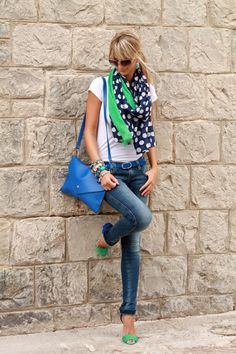 This shows how a pretty scarf can pull a t-shirt/jeans together....really like the blue & green in the purse & shoes. Its all about pulling it all together.