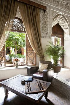 Shutters at DR window? Moroccan living room overlooking a gorgeous courtyard. Somewhere in Morocco. Moroccan Design, Moroccan Tiles, Moroccan Lanterns, Moroccan Theme, Modern Moroccan, Interior Exterior, Interior Architecture, Islamic Architecture, Design Marocain
